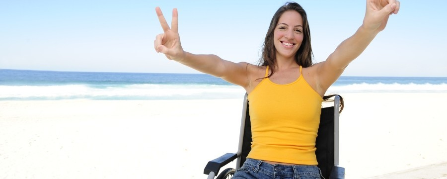 Woman happy in wheelchair because of Tax free for critical illness