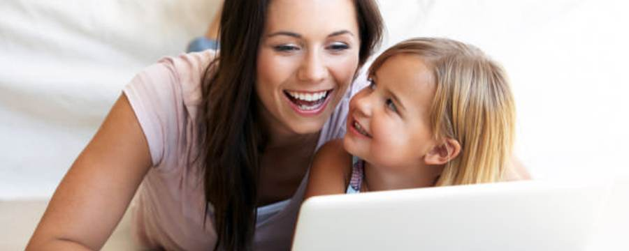 Mother searching online insurance for her daughter